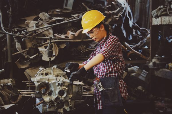 woman working on a motor factory